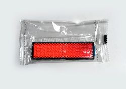 E-marked 90 x 25 mm, adhesive: Reflector, rectangular, red